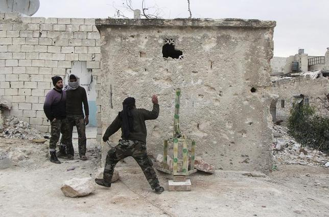 A member of the Free Syrian Army runs after placing a mortar shell inside a launcher during what activists said were clashes with pro-government forces, beside Hanano barracks in Aleppo's Karm al-Jabal district, December 10, 2013. REUTERS/Saad AboBrahim