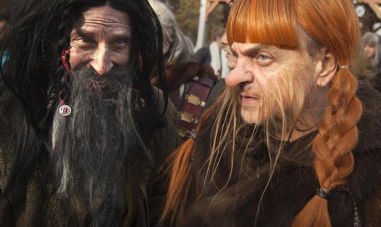 People dressed up as dwarves film a promotional video for the ''The Hobbit: The Desolation of Smaug'' at Belvedere Castle in Central Park, New York November 30, 2013. REUTERS/Carlo Allegri