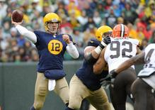 Oct 20, 2013; Green Bay, WI, USA; Green Bay Packers quarterback Aaron Rodgers (12) passes in the 1st quarter against the Cleveland Browns at Lambeau Field. Benny Sieu-USA TODAY Sports
