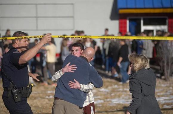 Students gather and reunite with their parents at a fast food joint across from Arapahoe High School, after a student opened fire in the school in Centennial, Colorado December 13, 2013. REUTERS/Evan Semon