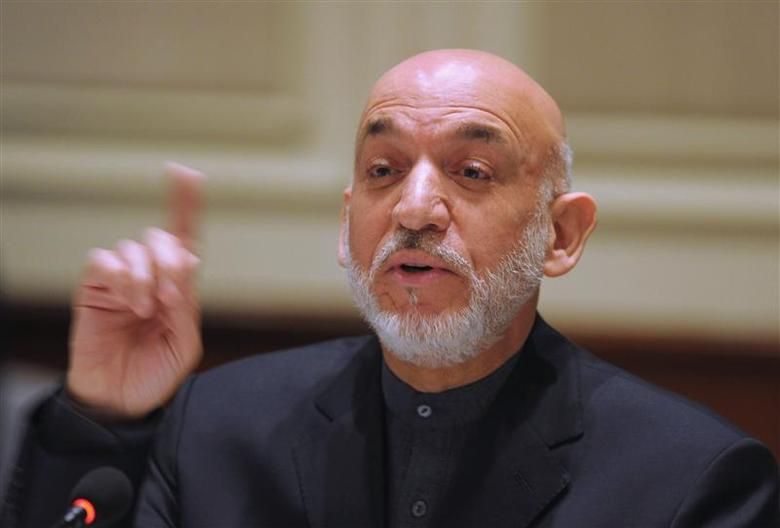 Afghanistan's President Hamid Karzai gestures as he addresses media representatives during a press interaction in New Delhi December 14, 2013. REUTERS/Findlay Kember/Pool