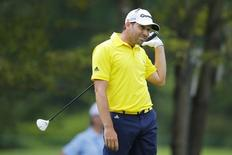 Sergio Garcia of Spain watches his tee shot on the fourth hole during the final round of the Deutsche Bank Championship golf tournament in Norton, Massachusetts September 2, 2013. REUTERS/Brian Snyder