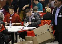 "Volunteers of the Social Democratic Party count the ballots of the ""Member Vote"" for a new ""grand coalition"" between the Social Democratic Party (SPD) and the Christian Democratic Union (CDU) in Berlin, December 14, 2013. REUTERS/Fabrizio Bensch"