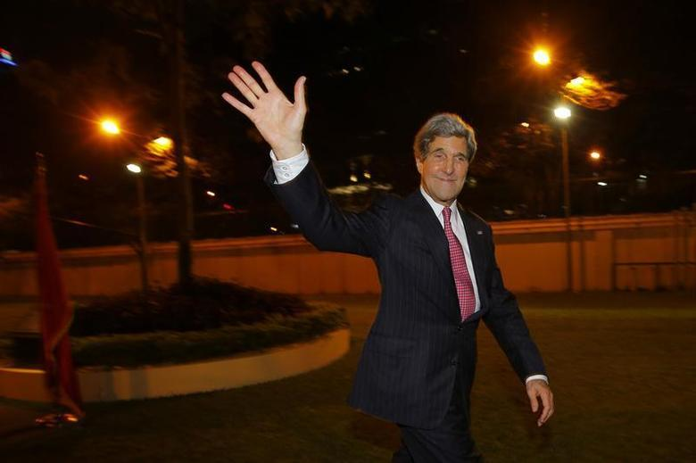 U.S. Secretary of State John Kerry waves to the crowd after greeting staff at the U.S. Consulate in Ho Chi Minh City December 14, 2013. REUTERS/Brian Snyder