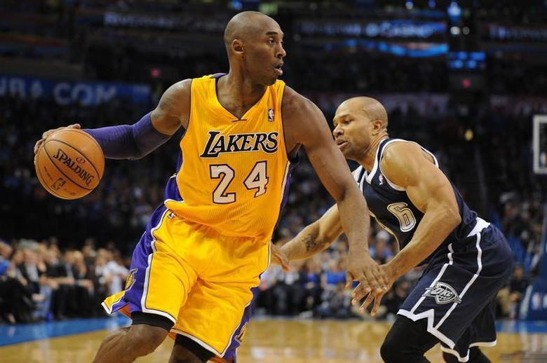 Dec 13, 2013; Oklahoma City, OK, USA; Los Angeles Lakers shooting guard Kobe Bryant (24) dribbles the ball around Oklahoma City Thunder point guard Derek Fisher (6) during the second quarter at Chesapeake Energy Arena. Mark D. Smith-USA TODAY Sports