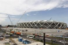The Arena Amazonia stadium is under construction to host several 2014 World Cup soccer games, in Manaus December 14, 2013. Construction worker Marcleudo de Melo Ferreira fell to his death from the roof earlier in the day after a cable broke, adding to safety concerns as the country races to finish building in time to host the 2014 World Cup of soccer. REUTERS/Bruno Kelly