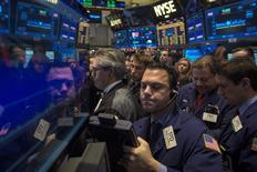 Traders work on the floor of the New York Stock Exchange December 12, 2013. REUTERS/Brendan McDermid