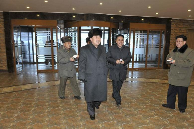 North Korean leader Kim Jong Un (C) visits the Masik-Ryong Ski Resort, which is near completion, near Wonsan in this undated photo released by North Korea's Korean Central News Agency (KCNA) in Pyongyang December 15, 2013. REUTERS/KCNA