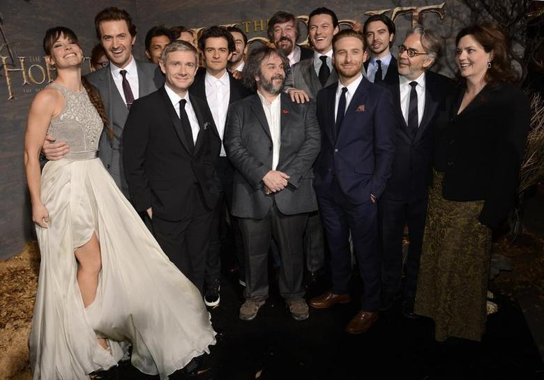Cast and crew members pose for photographers at the premiere of the film ''The Hobbit: The Desolation of Smaug'' in Los Angeles December 2, 2013. REUTERS/Phil McCarten