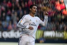 L'attaquant du Real Madrid Cristiano Ronaldo a inauguré dimanche sur son île natale de Madère un musée à sa gloire, suffisamment grand pour accueillir un éventuel nouveau Ballon d'or. /Photo prise le 14 décembre 2013/REUTERS/Vincent West
