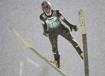 Thomas Morgenstern of Austria competes during the FIS World Cup ski jumping mixed team competition in Lillehammer, December 6, 2013. REUTERS/Geir Olsen/TT News Agency