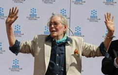 Irish-born actor Peter O'Toole displays his cement-covered hands after placing his handprints in cement during hand and footprint ceremonies honoring him at Grauman's Chinese Theatre in Hollywood April 30, 2011. REUTERS/Fred Prouser