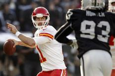 Dec 15, 2013; Oakland, CA, USA; Kansas City Chiefs quarterback Alex Smith (11) prepares to throw a pass against the Oakland Raiders in the second quarter at O.co Coliseum. Mandatory Credit: Cary Edmondson-USA TODAY Sports - RTX16K9Q
