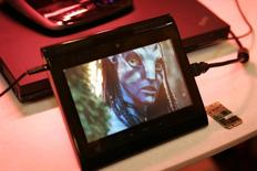 "A prototype Internet tablet plays an ""Avatar"" movie trailer being streamed in 1080p high definition over a 4G LTE wireless network at the 2010 International Consumer Electronics Show (CES) in Las Vegas, Nevada, January 7, 2010. REUTERS/Steve Marcus"