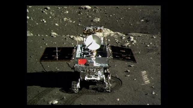A view of China's first moon rover, Yutu, or Jade Rabbit, is seen on the lunar surface with the Chinese national flag in this still image taken from video provided by China Central Television (CCTV) December 16, 2013. REUTERS/CCTV via Reuters TV