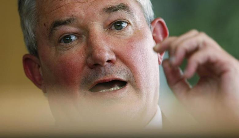 Group Chief Executive of the Bank Of Ireland, Richie Boucher, gestures during an interview with Reuters at the company's head office in Dublin, Ireland June 12,2009. REUTERS/Cathal McNaughton