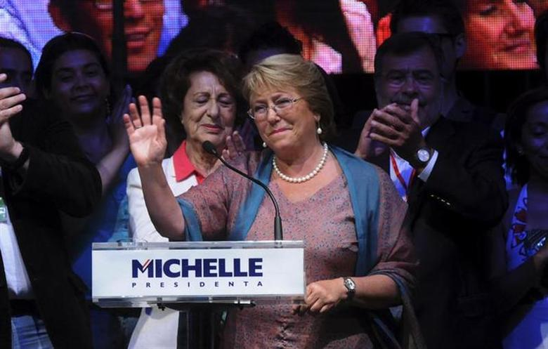 Chilean presidential candidate Michelle Bachelet waves after winning Chile's presidential elections, in Santiago December 15, 2013. REUTERS/Maglio Perez