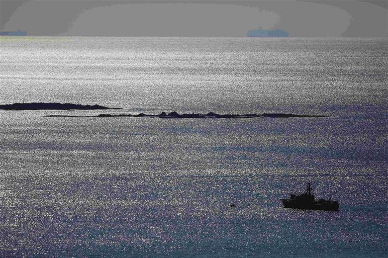 An Israeli naval vessel sails in the Mediterranean sea near Lebanon December 16, 2013. Israeli, Lebanese and U.N. military officers will meet on Monday to defuse tension after a ''rogue'' Lebanese soldier shot dead an Israeli soldier the day before, Israel's defence minister said. REUTERS/Amir Cohen