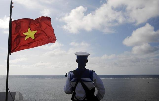 A Vietnamese naval soldier stands quard at Thuyen Chai island in the Spratly archipelago January 17, 2013. REUTERS/Quang Le