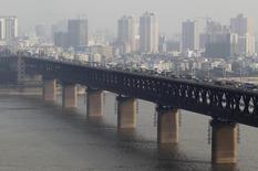 En choisissant Wuhan pour son implantation en Chine, Renault va contribuer à faire de la ville, siège de son partenaire local Dongfeng Motor Group, le Detroit du pays. /Photo d'archives/REUTERS