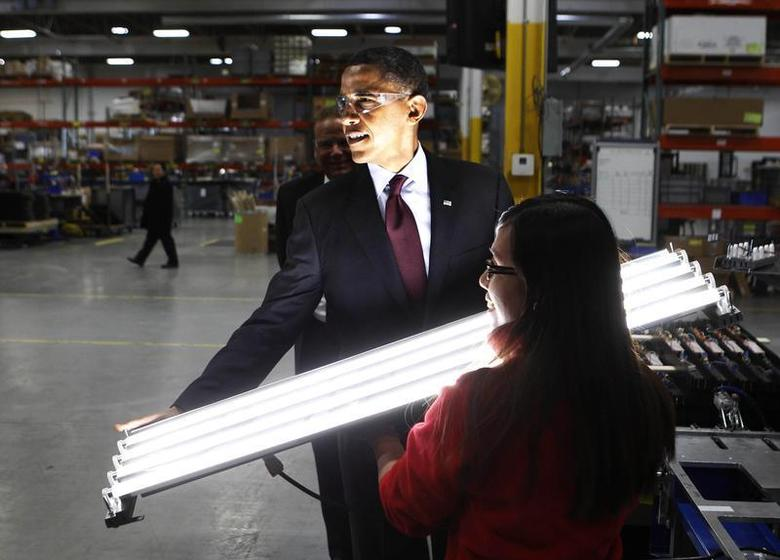 U.S. President Barack Obama holds a newly manufactured light as he tours Orion Energy Systems, a power technology company, as part of his Administration's White House to Main Street Tour, in Manitowoc, Wisconsin, January 26, 2011. REUTERS/Larry Downing