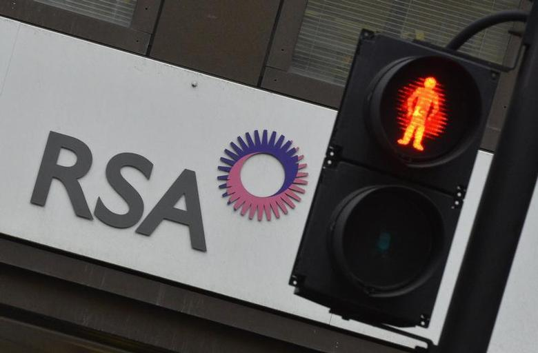 A sign of RSA insurance company is pictured outside its office in London December 13, 2013. REUTERS/Toby Melville