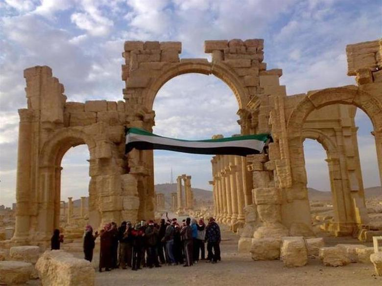 Demonstrators protest against Syria's President Bashar al-Assad after Friday prayers in the ancient city of Palmyra, in the heart of the Syrian desert November 18, 2011. REUTERS/Handout/Files