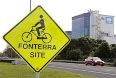 The Fonterra Te Rapa plant is seen behind a sign for cyclists near Hamilton, in this August 6, 2013 file picture. REUTERS/Nigel Marple/Files