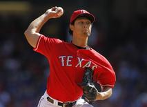 Texas Rangers starting pitcher Yu Darvish pitches against the Los Angeles Angels in the fourth inning of their MLB American League baseball game in Arlington, Texas September 29, 2013. REUTERS/Mike Stone