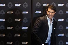 Spanish tennis player Rafael Nadal arrives for a news conference before a celebrity poker tournament, the European Poker Tour Charity Challenge, in Prague December 12, 2013. REUTERS/David W Cerny