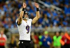 Dec 16, 2013; Detroit, MI, USA; Baltimore Ravens kicker Justin Tucker (9) celebrates after kicking a field goal during the third quarter against the Detroit Lions at Ford Field. Mandatory Credit: Andrew Weber-USA TODAY Sports