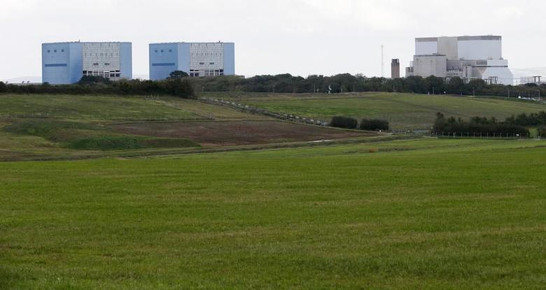 Hinkley Point A and B nuclear power stations are seen behind the site where EDF Energy's Hinkley Point C nuclear power station will be constructed in Bridgwater, southwest England October 24, 2013 file photo. REUTERS/Suzanne Plunkett