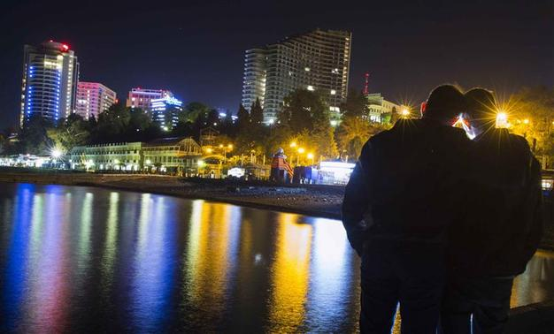 Gay rights activist Vladislav Slavsky (R) poses for a photograph with his boyfriend, who wants to remain anonymous, at the Black Sea promenade in Sochi, south western Russia October 21, 2013. REUTERS/Thomas Peter