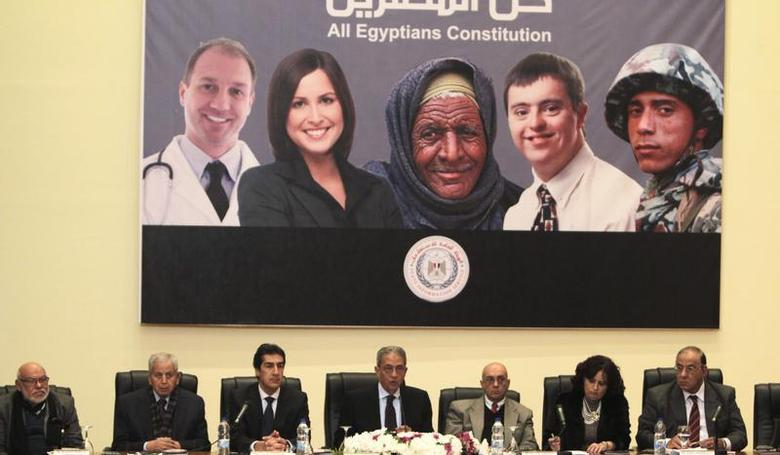 Egypt's constituent assembly Chairman Amr Moussa (C) attends a news conference in Cairo December 15, 2013. REUTERS/Mohamed Abd El Ghany