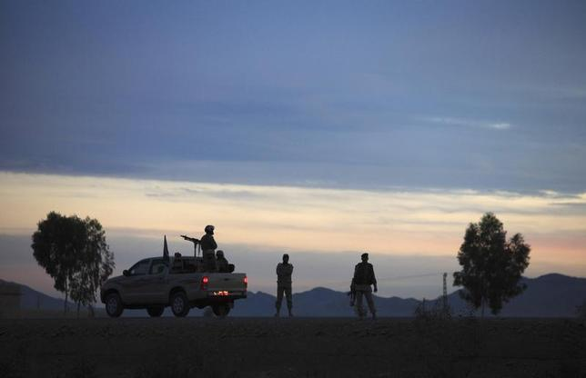 Pakistani army soldiers stop over during their patrol in in Wana November 27, 2012. REUTERS/Faisal Mahmood