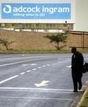 A man walks past the Adcock Ingram offices in Johannesburg December 3, 2013. REUTERS/Siphiwe Sibeko