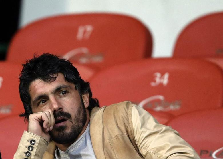 Injured FC Sion player Gennaro Gattuso sits in the tribune before the start of the second half of their Swiss Super League soccer match against Grasshopper (GC) in Sion May 16, 2013. REUTERS/Denis Balibouse
