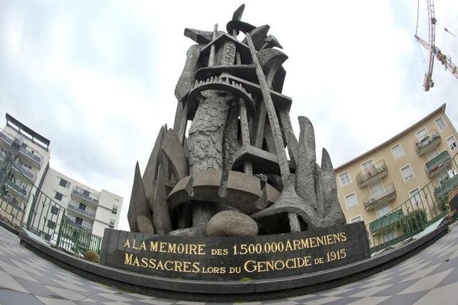 A monument with the inscription at its base, ''To the Memory of the the 1,500,000 Armenians who were Massacred during the Genocide in 1915'' is seen in a square in Decines, near Lyon, December 22, 2011. REUTERS/Robert Pratta