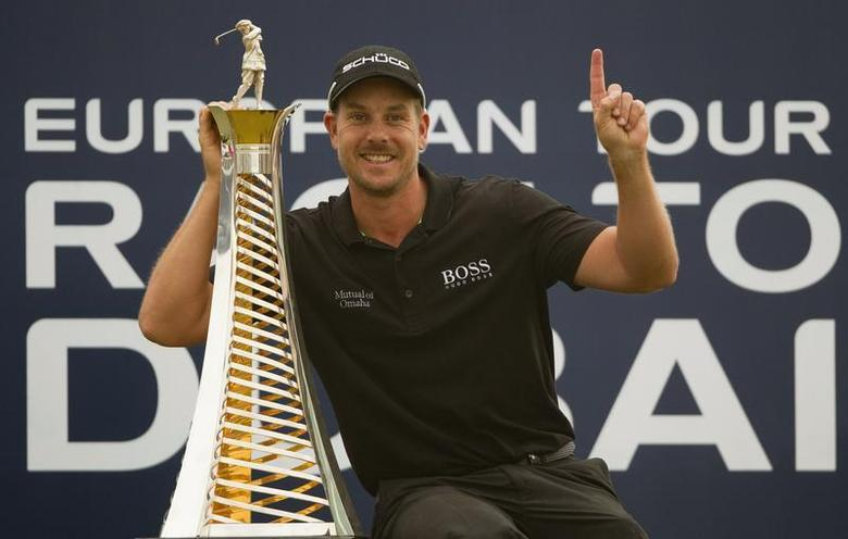 Henrik Stenson of Sweden poses with his 2013 Race to Dubai trophy after winning the DP World Tour Championship in Dubai November 17, 2013. REUTERS/Caren Firouz