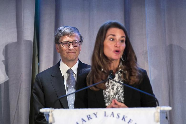 Microsoft co-founder Bill Gates listens to his wife Melinda speak after accepting an award from the Albert and Mary Lasker Foundation in New York September 20, 2013. REUTERS/Lucas Jackson