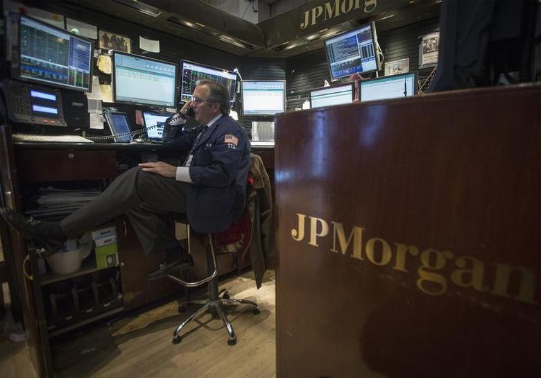 A trader works at the JP Morgan stall on the floor of the New York Stock Exchange, November 19, 2013. REUTERS/Brendan McDermid