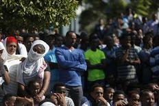 African migrants watch a memorial service for the deaths of hundreds of migrants in last week's Lampedusa boat disaster, in Tel Aviv October 12, 2013. REUTERS/Nir Elias