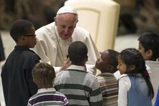 Pope Francis greets children assisted by volunteers of Santa Marta institute during an audience in Paul VI hall at the Vatican December 14, 2013. REUTERS/Giampiero Sposito