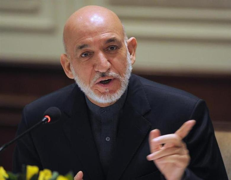 Afghanistan's President Hamid Karzai addresses media representatives during a press interaction in New Delhi December 14, 2013. Karzai is on a four-day visit to India. REUTERS/Findlay Kember/Pool