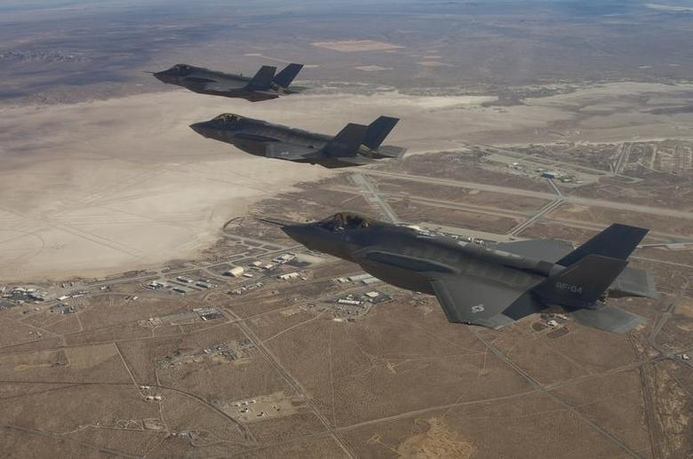 Three F-35 Joint Strike Fighters (rear to front) AF-2, AF-3 and AF-4, fly over Edwards Air Force Base, December 10, 2011. REUTERS/Lockheed Martin/Darin Russell