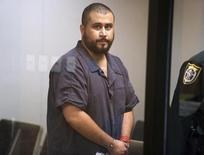 George Zimmerman, the acquitted shooter in the death of Trayvon Martin, arrives in Courtroom J2 to face a Seminole circuit judge in Sanford, Florida November 19, 2013. REUTERS/Joe Burbank/Orlando Sentinel/Pool