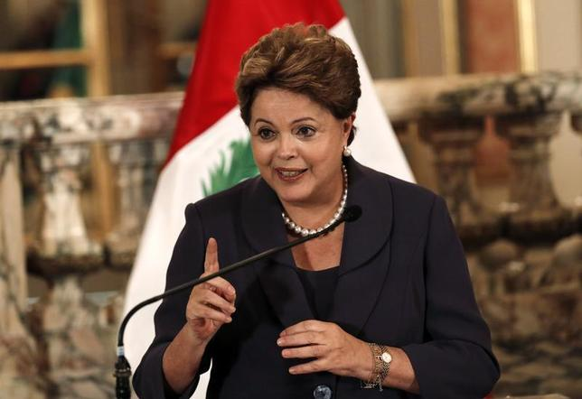 Brazil's President Dilma Rousseff speaks to the press at the government palace in Lima, November 11, 2013. Rousseff is on a one-day official visit to Peru. REUTERS/Mariana Bazo