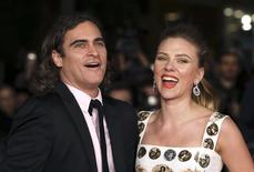 "Cast members Joaquin Phoenix (L) and Scarlett Johansson (R) arrive for a red carpet event for the movie ""Her"" at the Rome Film Festival, in this file photo from November 10, 2013. REUTERS/Alessandro Bianchi/Files"