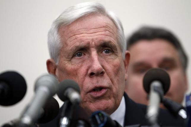 U.S. Representative Frank Wolf (R-VA) speaks with Rep. Chris Smith (R-NJ) (obscured) during a news conference on Capitol Hill in Washington, January 18, 2011. REUTERS/Hyungwon Kang