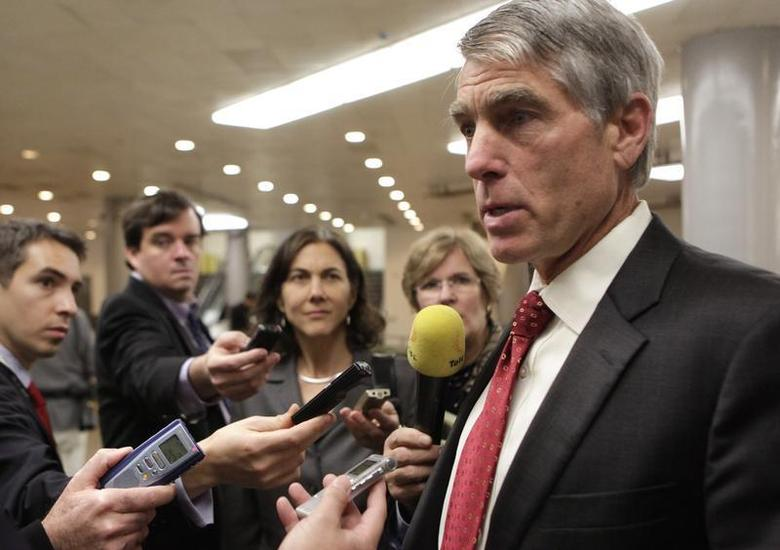 Senator Mark Udall (D-CO) talks to the media after former CIA Director David Petraeus testified at a Senate Intelligence Committee closed hearing on Capitol Hill in Washington, November 16, 2012. REUTERS/Yuri Gripas